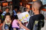 CAMPO-Kindertagesstätten: Kinder lesen sich gegenseitig vor