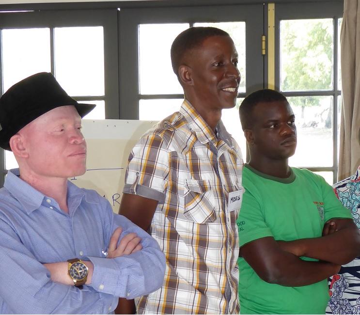 "3 Männer auf der STEPS-Konferenz ""Film als Mittel für Sozialen Wandel"": John (Albinism Foundation, Sambia), Moses (Direktor Refugee Law Project, Uganda), Blessing (TSURO, Simbabwe)"